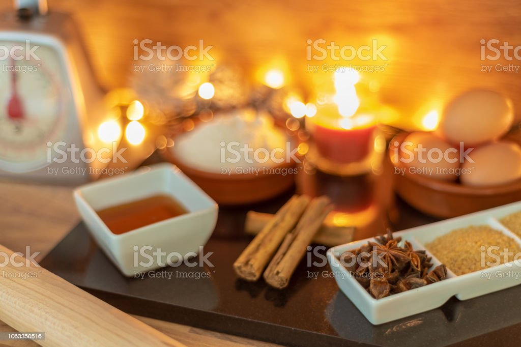 Baking ingredients at Christmas with cinnamon, eggs, star anise, sugar stock photo