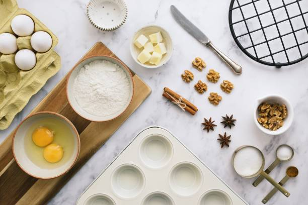 Baking ingredients background Baking ingredients from above muffin tin stock pictures, royalty-free photos & images