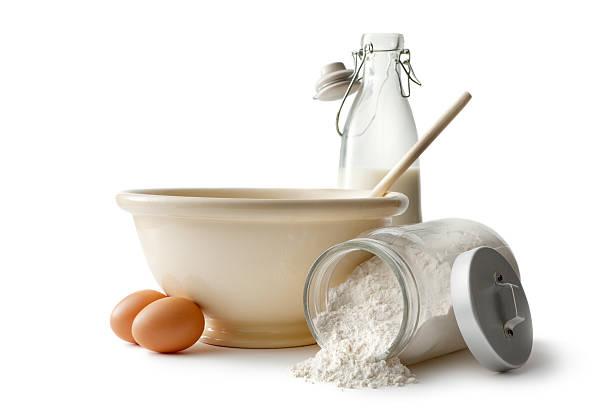 Baking Ingredients: Bowl, Eggs, Flour and Milk stock photo