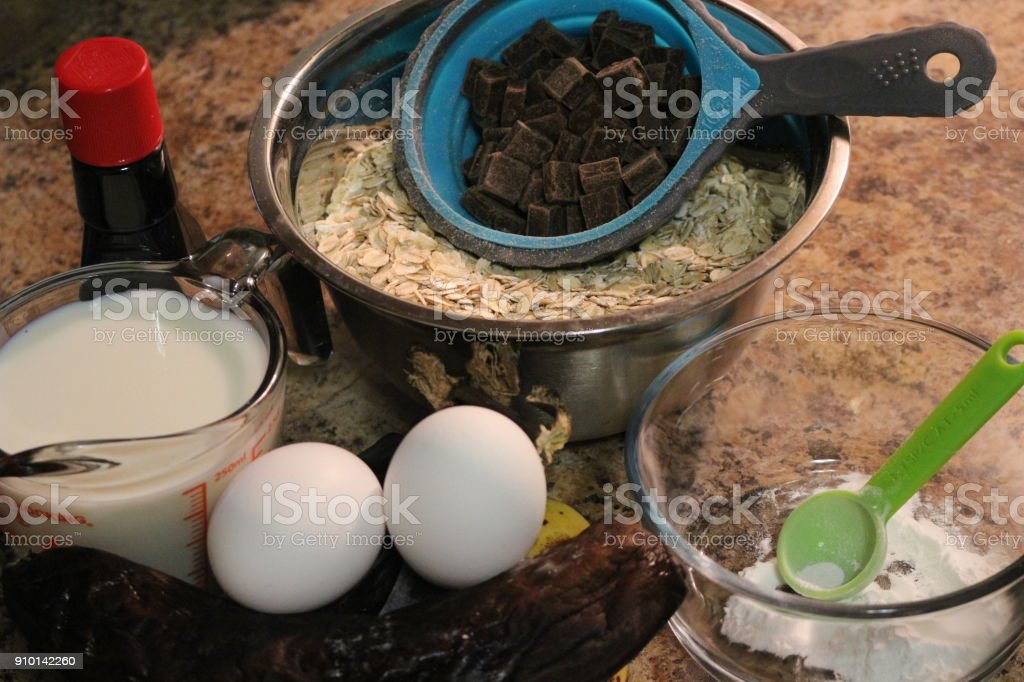 Baking ingredients for chocolate cake muffins or cookies lying ready on wooden kitchen tray. Mise en place, white background, measured ingredients Baking ingredients for chocolate cake muffins or cookies lying ready on wooden kitchen tray. Mise en place, white background, measured ingredients. winter is good time to bake Abundance Stock Photo