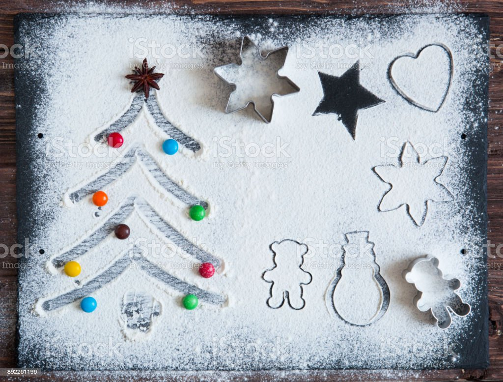 Baking ingredients for Christmas cookies on a dark table, ingredients for baking on dark background, top view stock photo