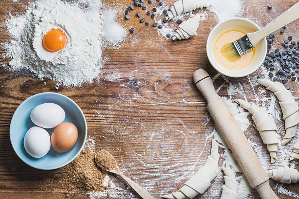 Baking ingredients for cooking croissants over wooden background, copy space stock photo