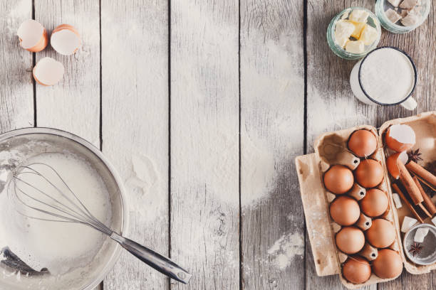 Baking ingredients on rustic wood background stock photo