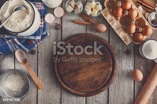 istock Baking ingredients on rustic wood background 849167306