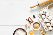 istock Baking ingredients on white table. Home baking concept 908921188