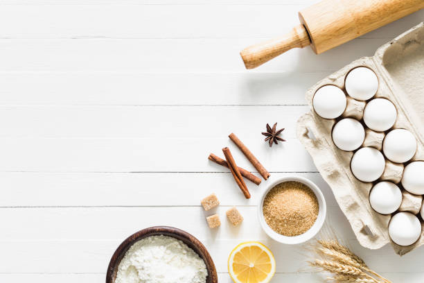 Baking ingredients on white table. Home baking concept stock photo