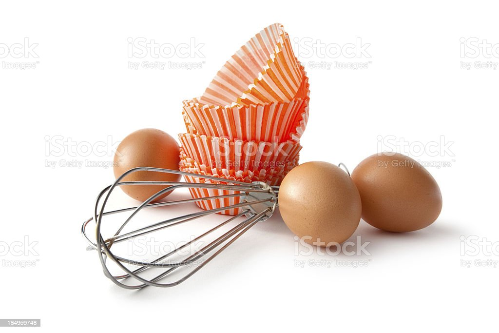 Baking Ingredients: Whisk and Paper Cups royalty-free stock photo