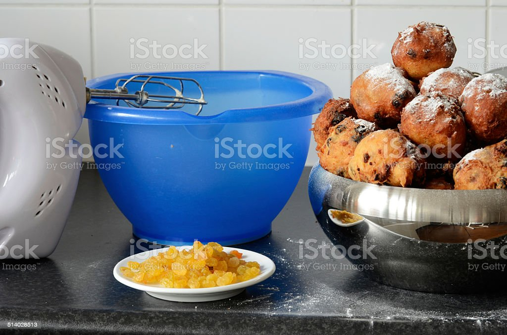 Baking oliebollen stock photo