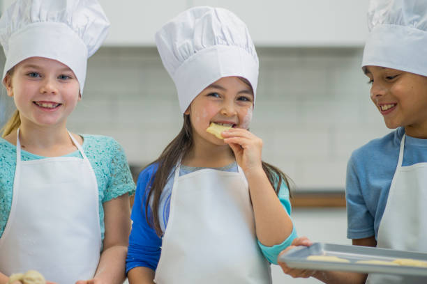 baking on a field trip - kids cooking stock photos and pictures