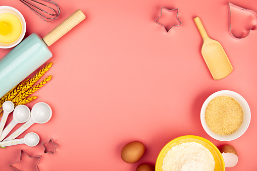 istock Baking or cooking ingredients on pink background, flat lay 1161304902
