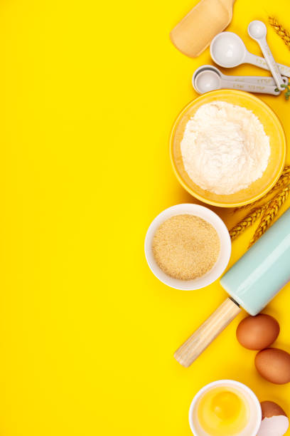 Baking or cooking ingredients on yellow background, flat lay stock photo