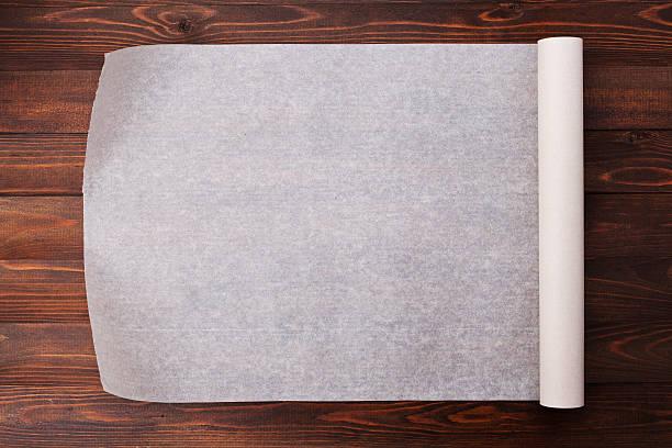 baking paper on wooden kitchen table for menu or recipes - bakplåt bildbanksfoton och bilder