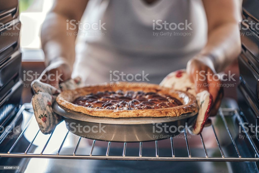 Baking Pecan Pie in The Oven for Holidays stock photo