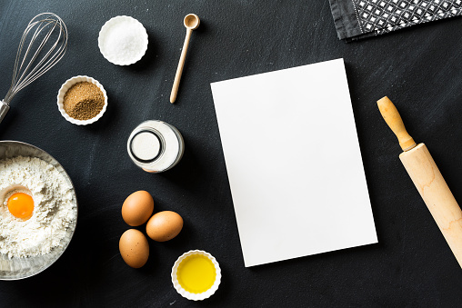 Baking recipe, blank white cover magazine on blackboard