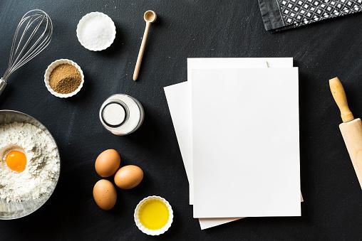 Baking recipe, blank white cover magazines on blackboard