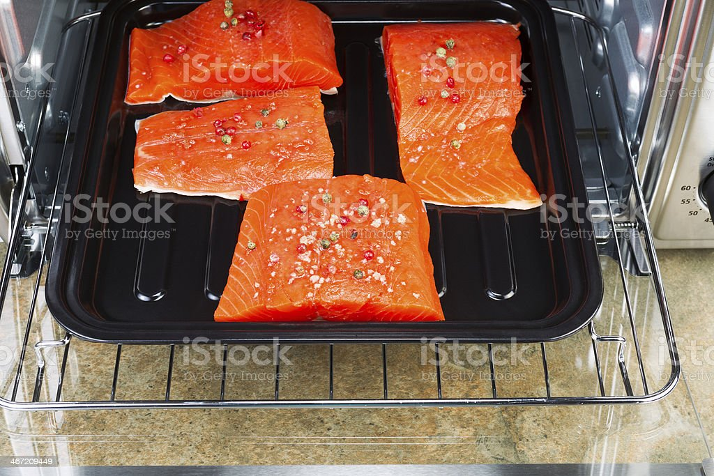 Baking Salmon in Oven royalty-free stock photo