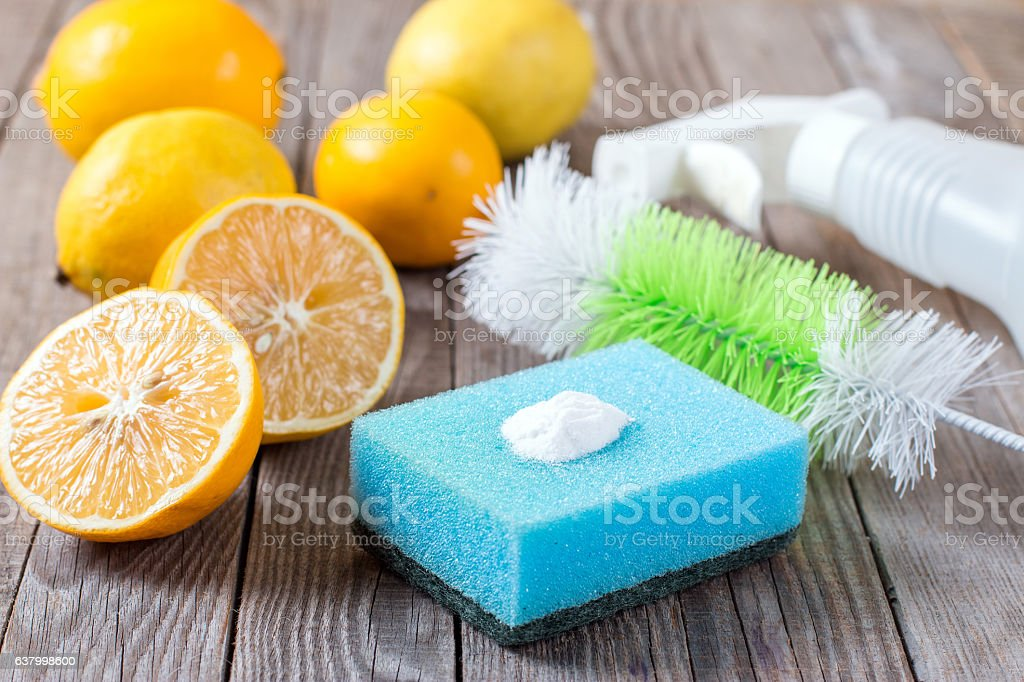 Baking soda and lemon on wooden table stock photo