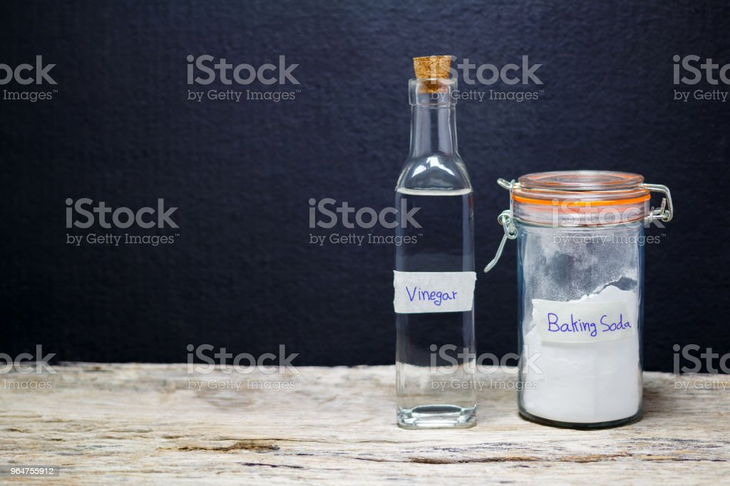 baking soda and vinegar on wooden background royalty-free stock photo