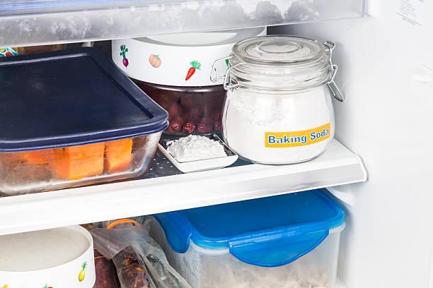 Baking soda placed in refrigerator to deodorize bad odor. stock photo