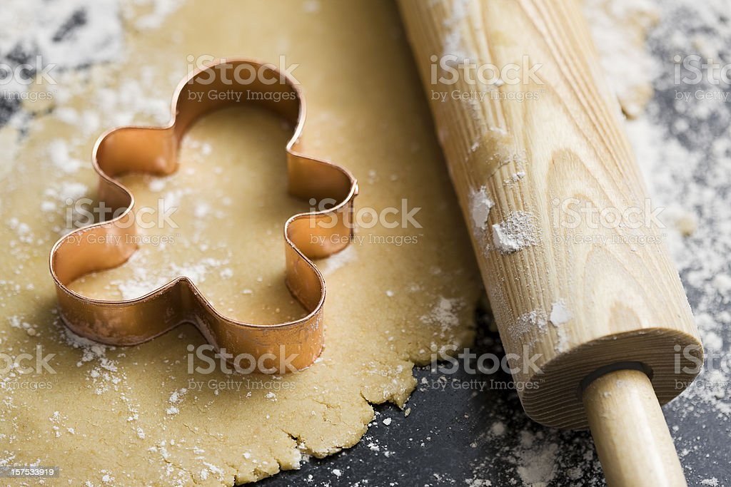 Baking Sugar Cookies with Gingerbread Man Cookie Cutter in Dough royalty-free stock photo