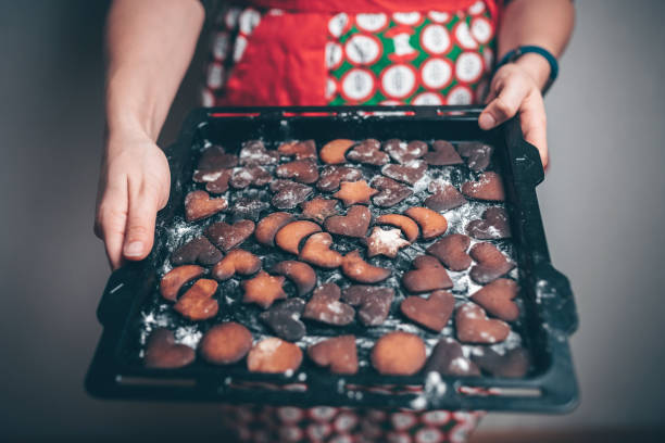 Baking tray with burnt gingerbread cookies stock photo