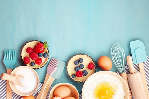 istock Baking utensils and cooking ingredients for tarts, cookies, dough and pastry. 1044200856