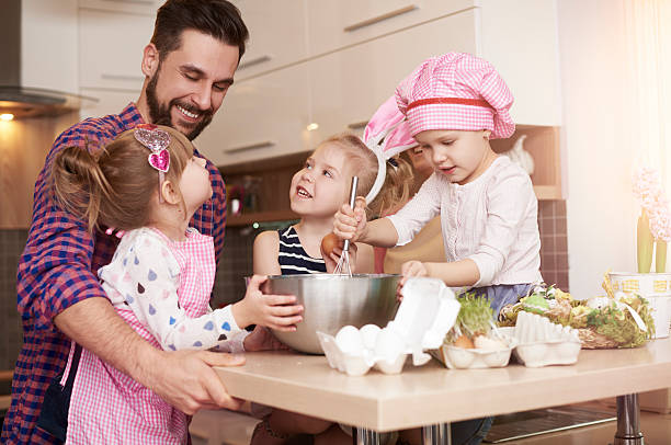 Baking with daughters for Easter time stock photo