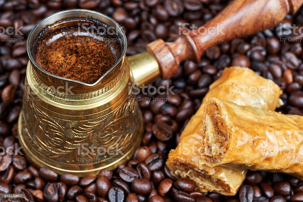 Baklava and hot black coffee in a traditional coffee pot stok fotoğrafı