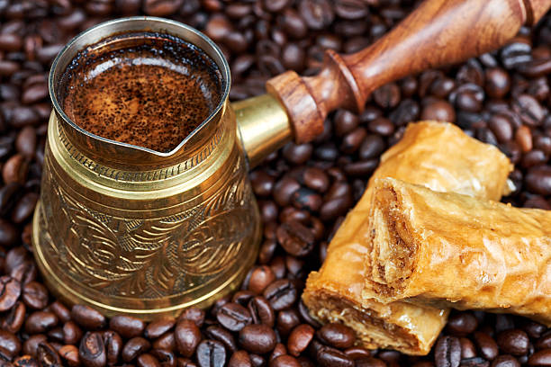 Baklava and hot black coffee in a traditional coffee pot stock photo