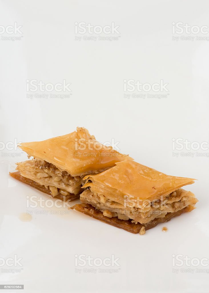 Baklava dripped with syrup on white background. stok fotoğrafı