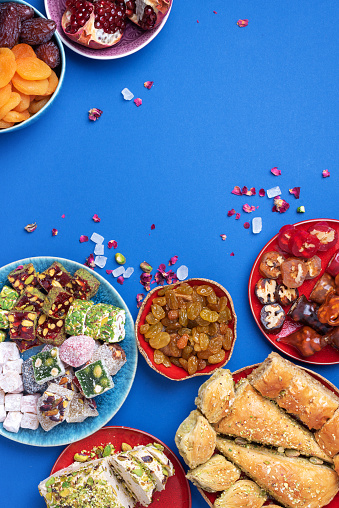 istock Baklava, halva, rahat lokum, sherbet, nuts, pistachios, dates, raisins, dried apricots, churchkhela. Assorted traditional eastern desserts, arabian sweets, turkish delight. Top view. Flat lay 1271667436