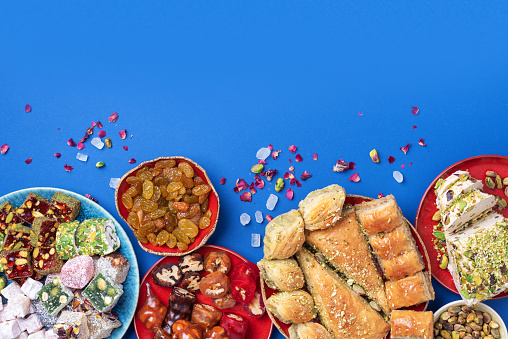 istock Baklava, halva, rahat lokum, sherbet, nuts, pistachios, dates, raisins, dried apricots, churchkhela. Assorted traditional eastern desserts, arabian sweets, turkish delight. Top view. Flat lay 1271667437
