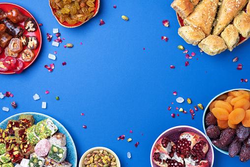 istock Baklava, halva, rahat lokum, sherbet, nuts, pistachios, dates, raisins, dried apricots, churchkhela. Assorted traditional eastern desserts, arabian sweets, turkish delight. Top view. Flat lay 1271667596