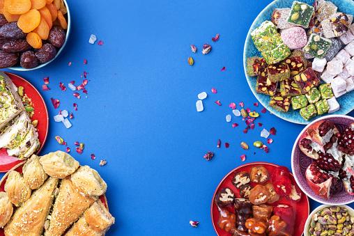 istock Baklava, halva, rahat lokum, sherbet, nuts, pistachios, dates, raisins, dried apricots, churchkhela. Assorted traditional eastern desserts, arabian sweets, turkish delight. Top view. Flat lay 1271667951