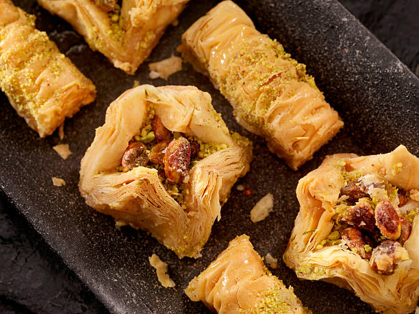 Baklava A delectable mouthwatering Filo Pastry desert with Pistachos, Honey, Cashews and Walnuts - Photographed on Hasselblad H3D2-39mb Camera armenian culture stock pictures, royalty-free photos & images
