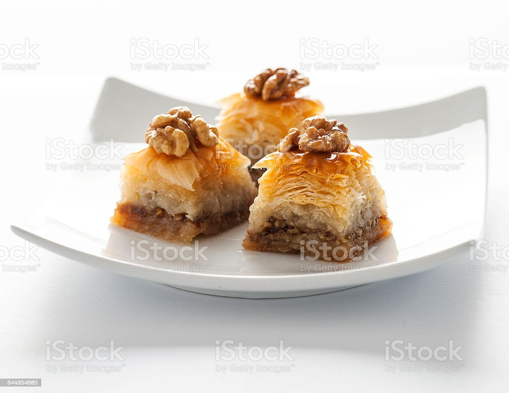 Baklava with honey and walnut on top - Photo