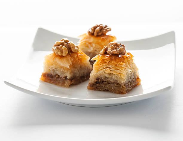 Baklava with honey and walnut on top - Photo