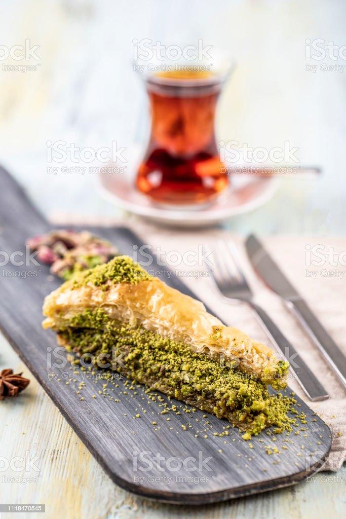 Baklava with pistachio. Turkish traditional dessert and Turkish Tea....