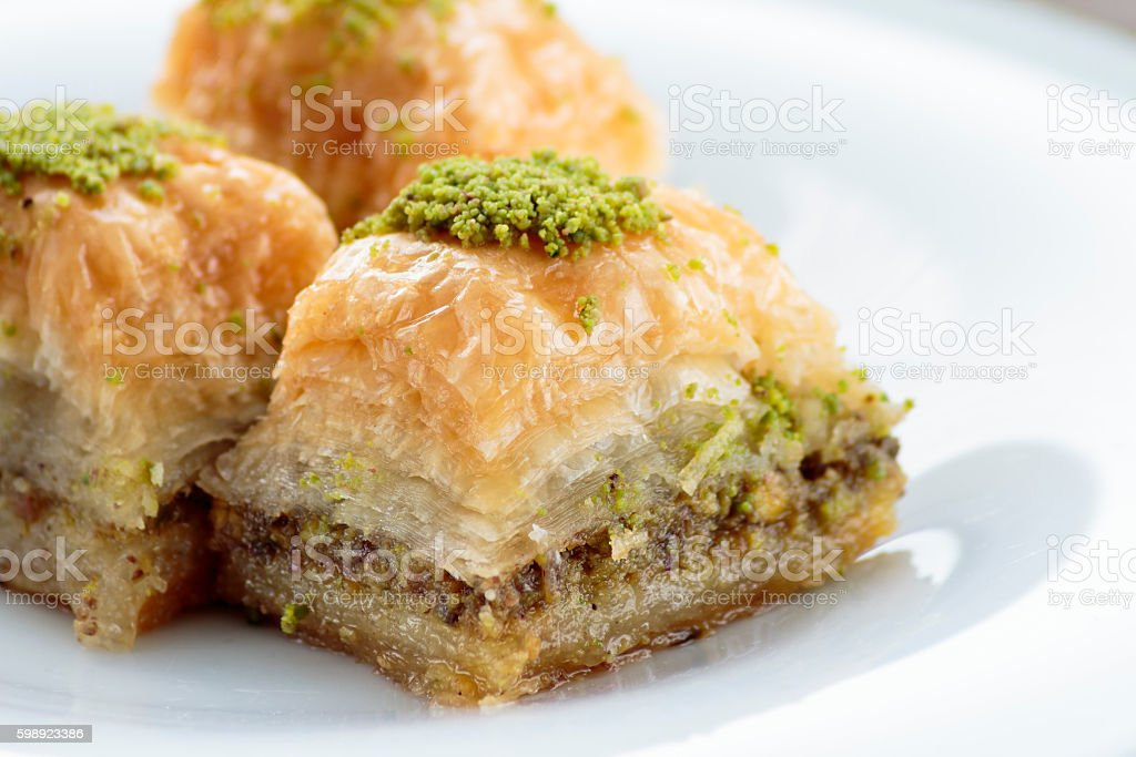 Baklava with pistachios and walnuts on white plate stock photo