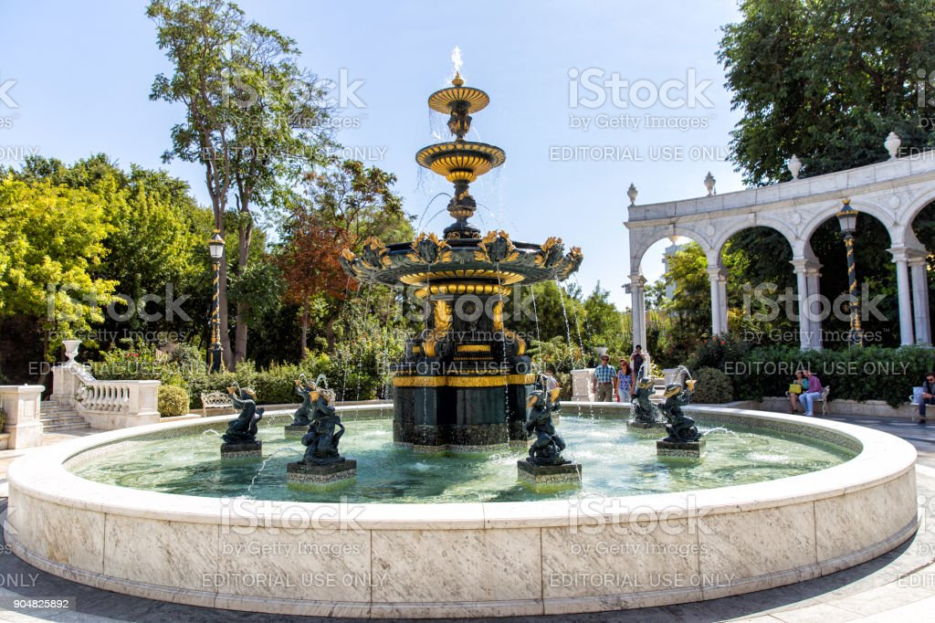Baku, Azerbaijan. Fountain in the park named after the poet Aliaga Vahid. The oldest park near the walls of the fortress Icheri Sheher stock photo