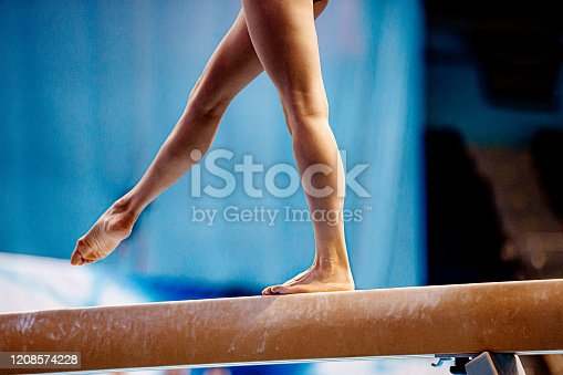 balance beam exercise legs young woman gymnast athlete