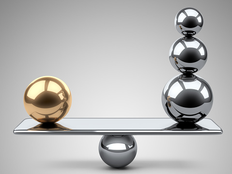 istock Balance between large gold and steel spheres. 484385774