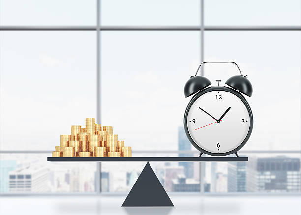 balance between time and money. A balance between time and money. On the one side is money, on the other one is an alarm clock. The concept of time is money. An office with New York panoramic view. 3D rendering. time is money stock pictures, royalty-free photos & images