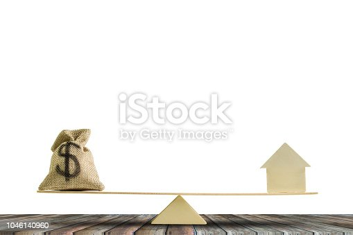 istock Balance home and money concept. 1046140960
