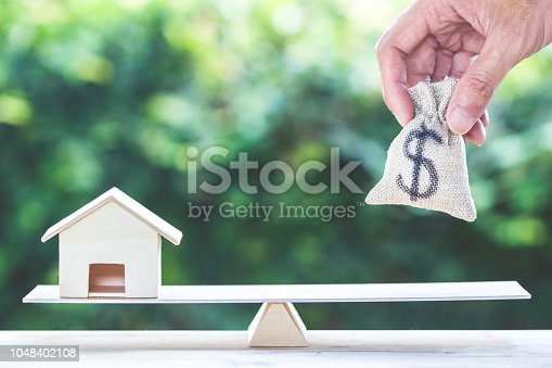 istock Balance home and money, home loan, reverse mortgage concept. 1048402108