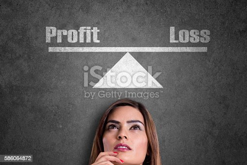 Businesswoman analyzing the business profit and loss.