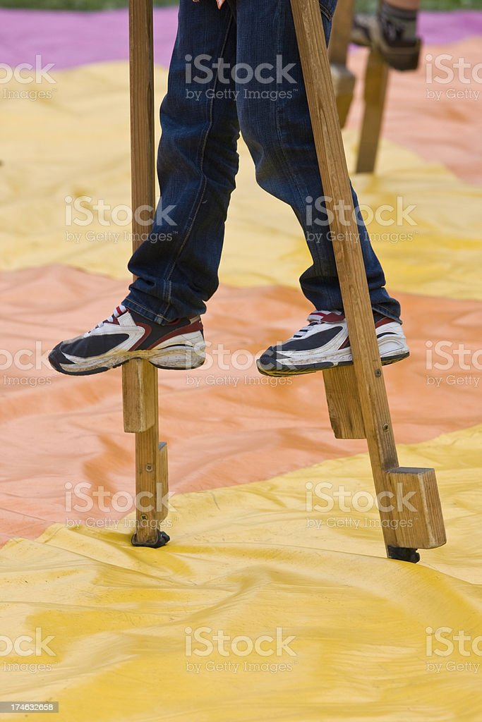 balance oneself on stilts stock photo