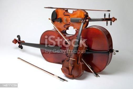 Studio Shot of Violin, Viola and Cello With Bows