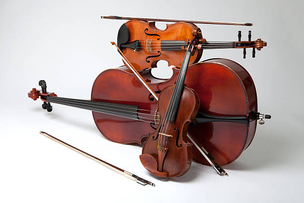Balance Studio Shot of Violin, Viola and Cello With Bows string instrument stock pictures, royalty-free photos & images