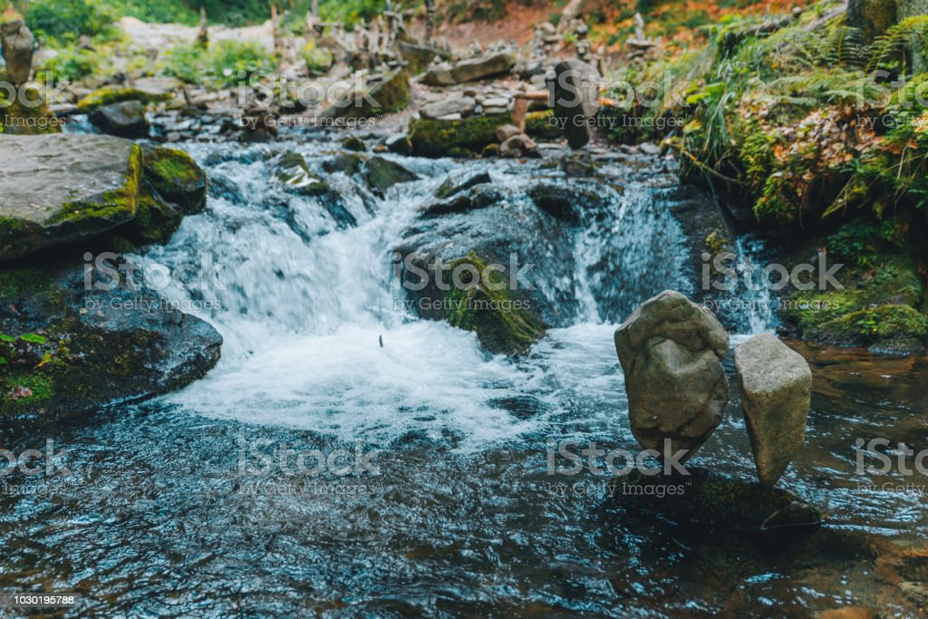 Balance Rocks In Mountains River Stream Stock Photo
